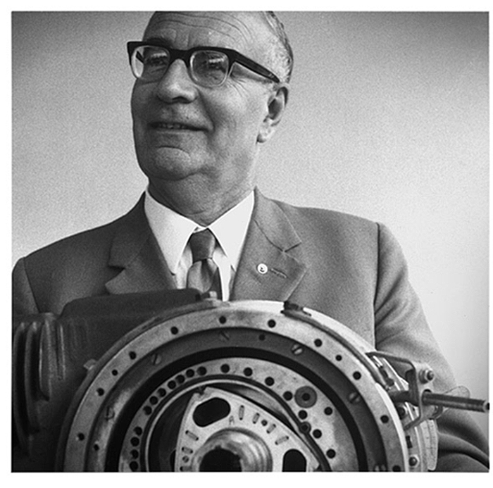 Dr. Felix Wankel posing with an early prototype of his rotary engine.